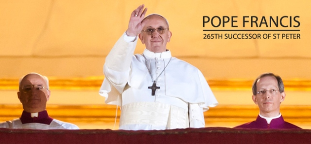 Pope Francis waves from the central balcony of St Peter's