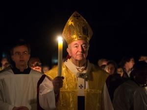 Cardinal-Vincent-Nichols-walks-prayerfully-with-a-lit-candle