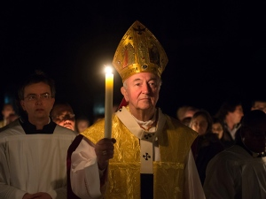 Cardinal-Vincent-Nichols-walks-prayerfully-with-a-lit-candle